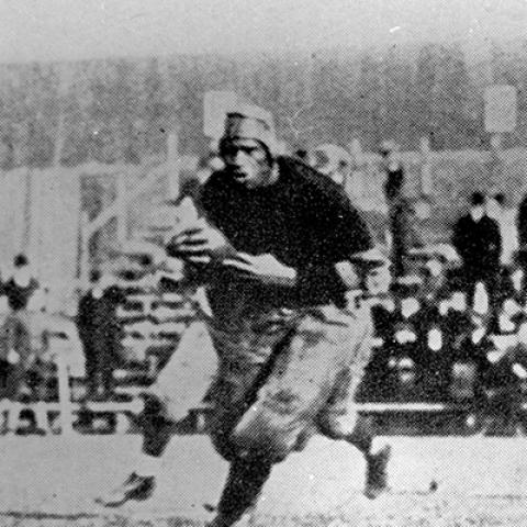 Paul Robeson running on the football field
